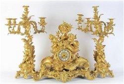 Figural Gilt Bronze Clock and Garniture