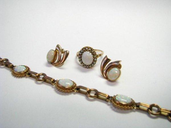 18: Gold and Opal Bracelet, Earrings, Ring