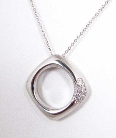 507: 18K White Gold Tiffany Diamond Pendant