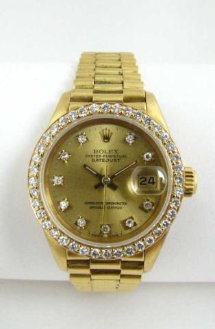 519: Lady's 18K Gold Rolex President, Diamond Bezel