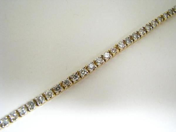 21: 14K Yellow Gold Lady's Diamond Bracelet