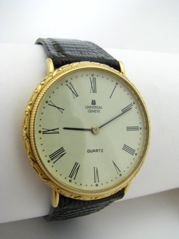 3: 18K Yellow Gold Universal Geneve Man's Watch