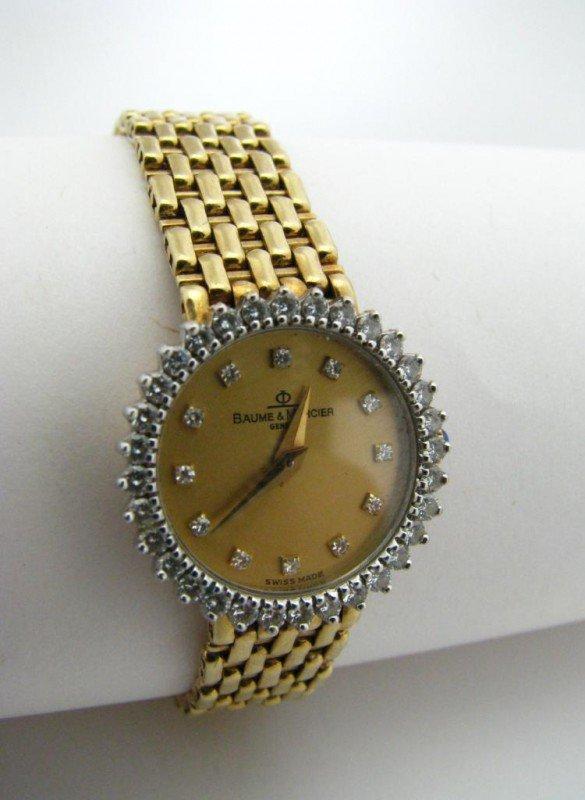 7: 14K Yellow Gold Baume & Mercier Watch