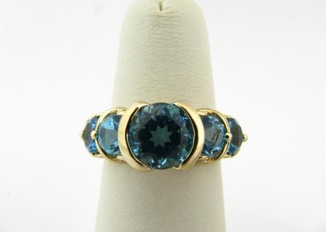 312: 10K Yellow Gold Blue Topaz Ring