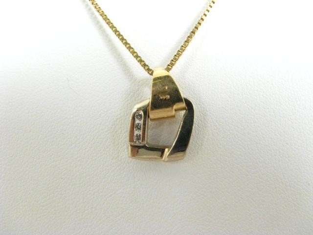 324: 14K Yellow Gold Diamond Pendant