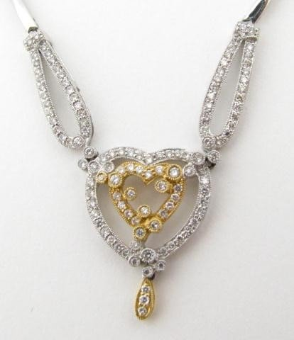 600: 18K Two-Tone Diamond Heart Shaped Necklace