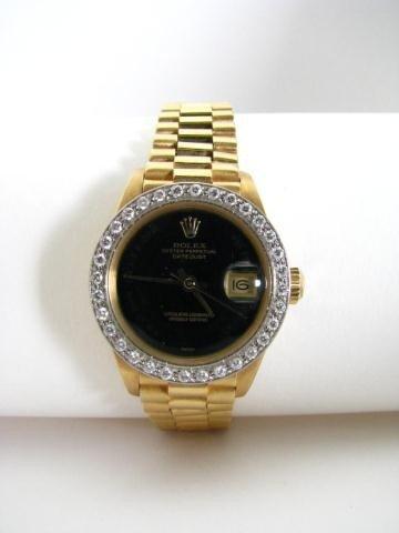 667: Lady's 18K Rolex Datejust, President