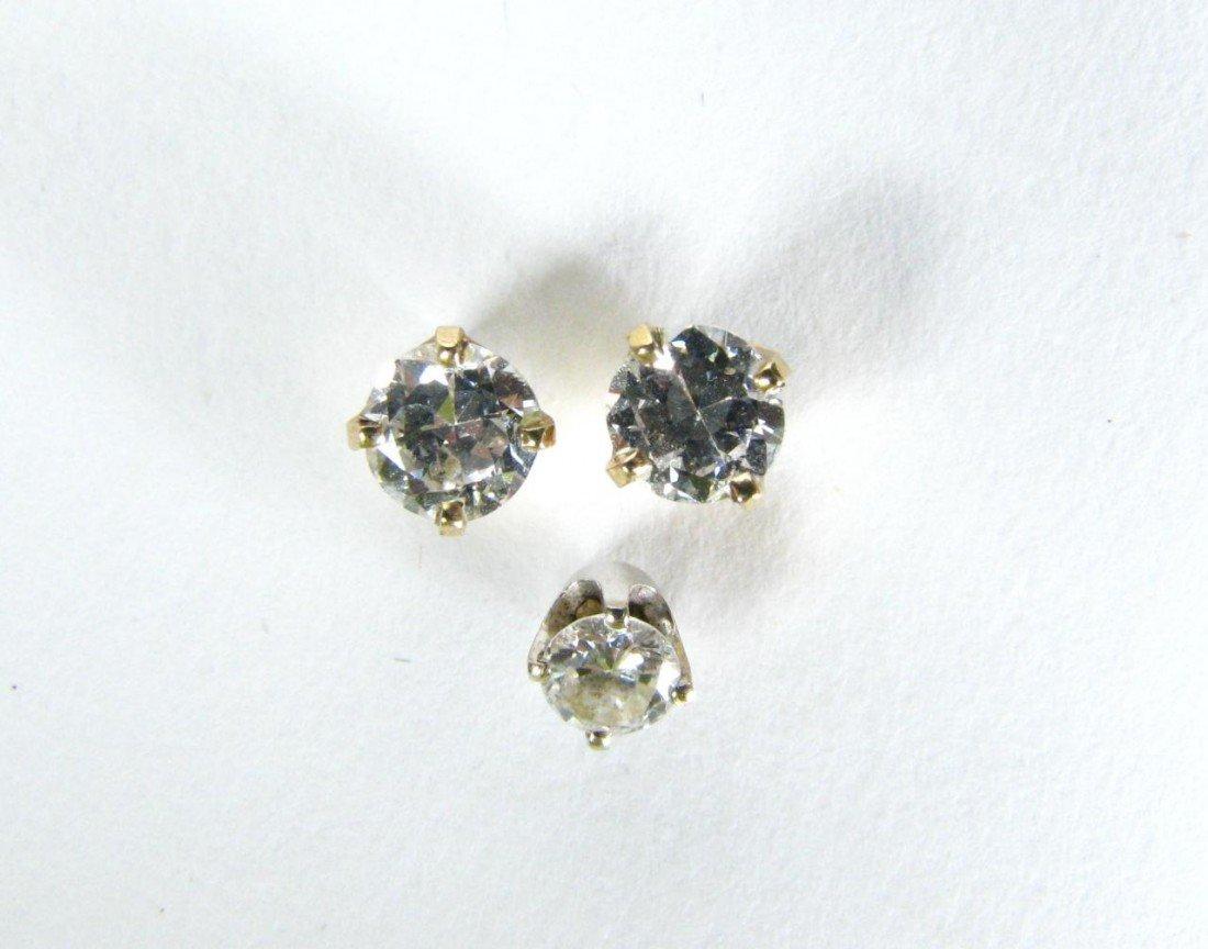 14: Diamond Stud Earrings, Pair plus one