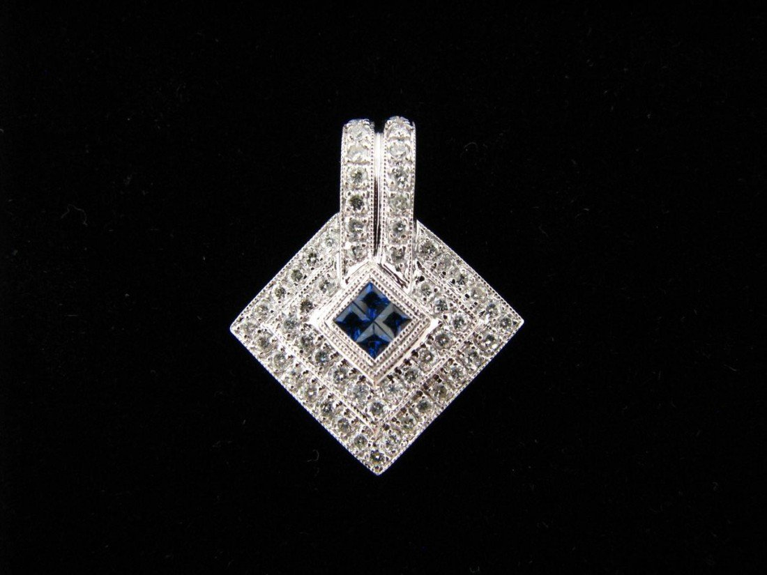 17: 14K White Gold Diamond and Sapphire Pendant