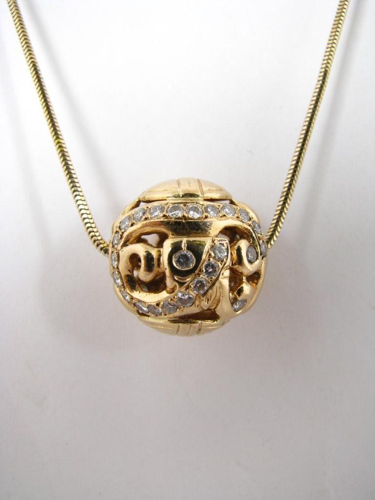 19: 14K Yellow Gold Diamond Ball Pendant