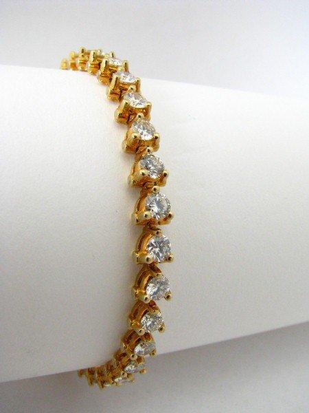 10: An 18K YG, 6ct Diamond Line Bracelet