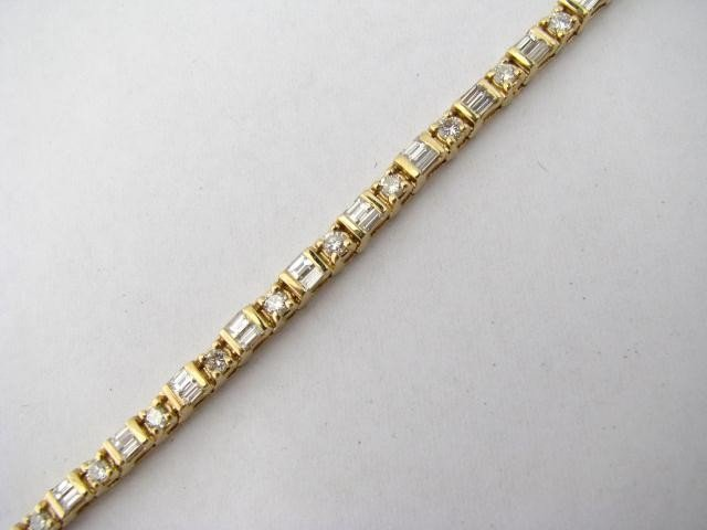 11: 14K Yellow Gold Lady's Diamond Line Bracelet