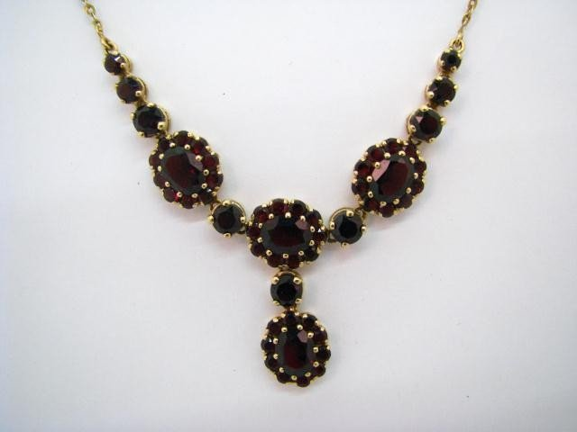 616: 14K Yellow Gold Garnet Necklace