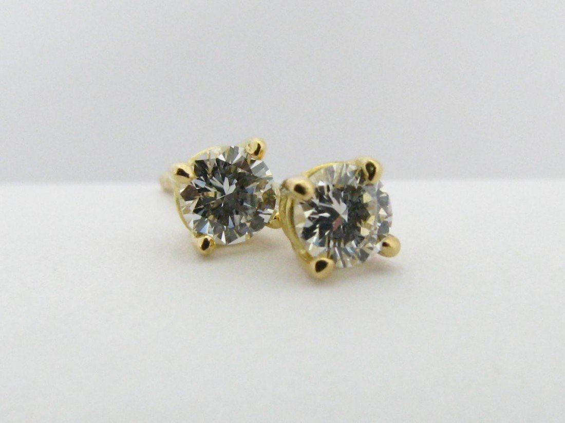 504: A Pair of Tiffany 18K Diamond Solitaire Earrings