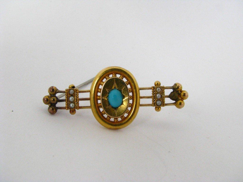 501B: An 18K Yellow Gold Etruscan Bar Pin, Turquoise &