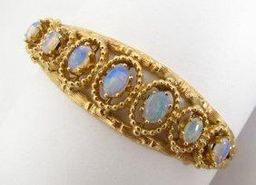 106: 14K Yellow Gold Opal Hinged Bangle Bracelet
