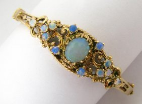 107: 14K Yellow Gold Opal Hinged Bangle Bracelet