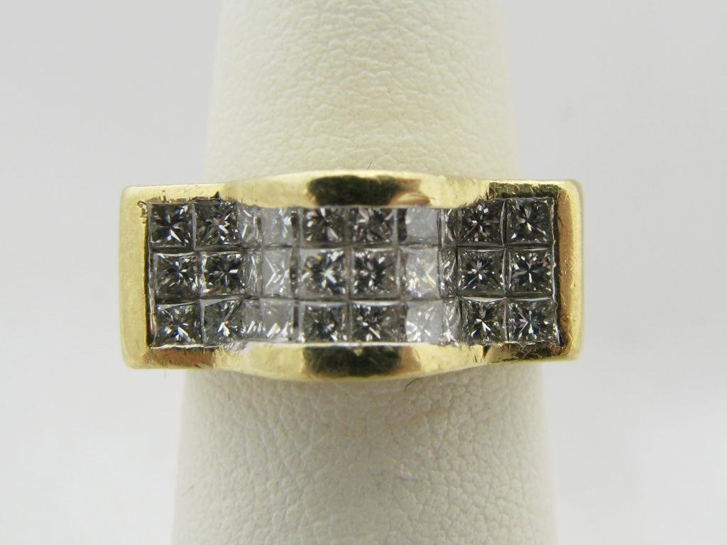 114: Lady's 18K YG Ring with Invisible Set Diamonds
