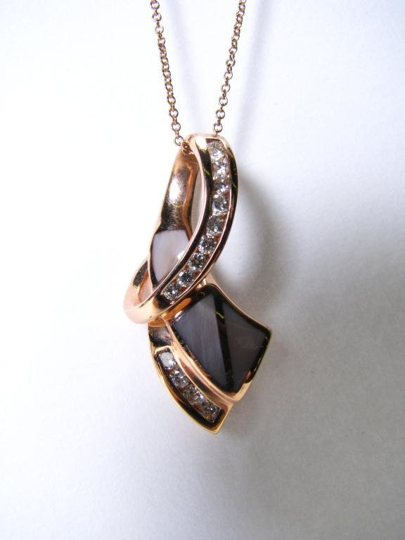 504: Lady's 14k YG Inlaid Mother of Pearl Pendant