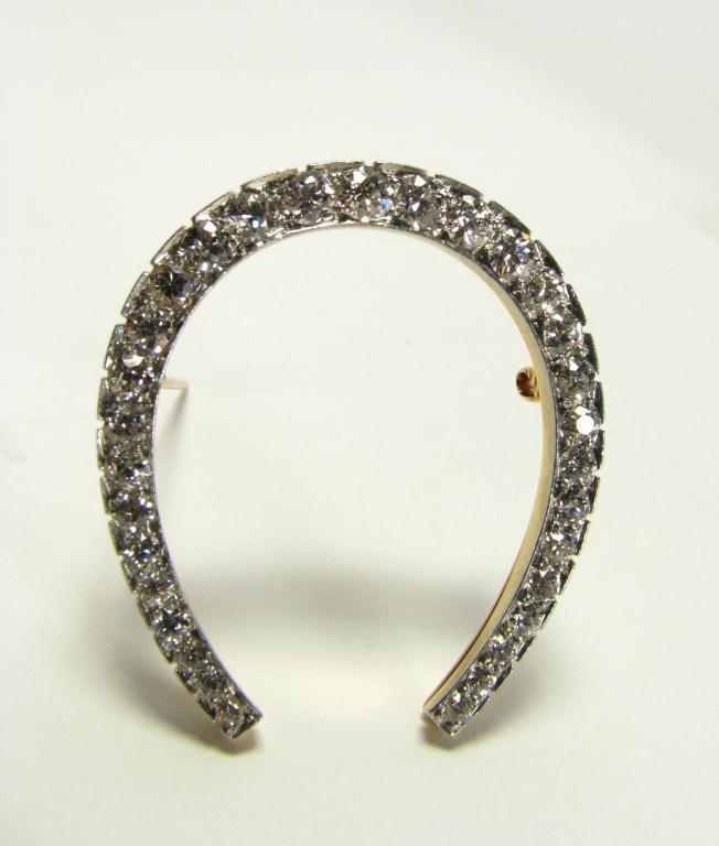 510: Platinum & 18k G Diamond Horseshoe Brooch