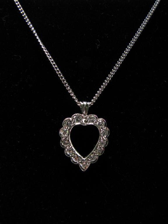518: Lady's White Gold Heart Shaped Diamond Pendant