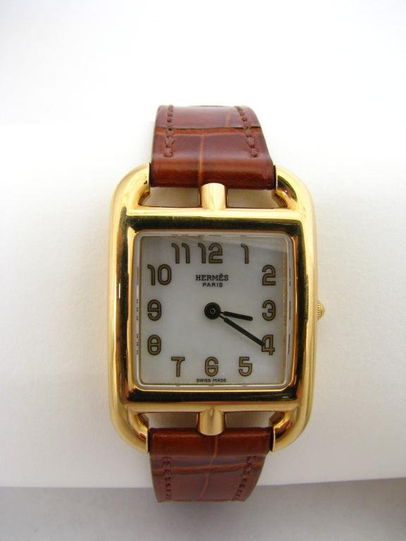 320: Lady's New Hermes 18k YG Cape Cod Watch