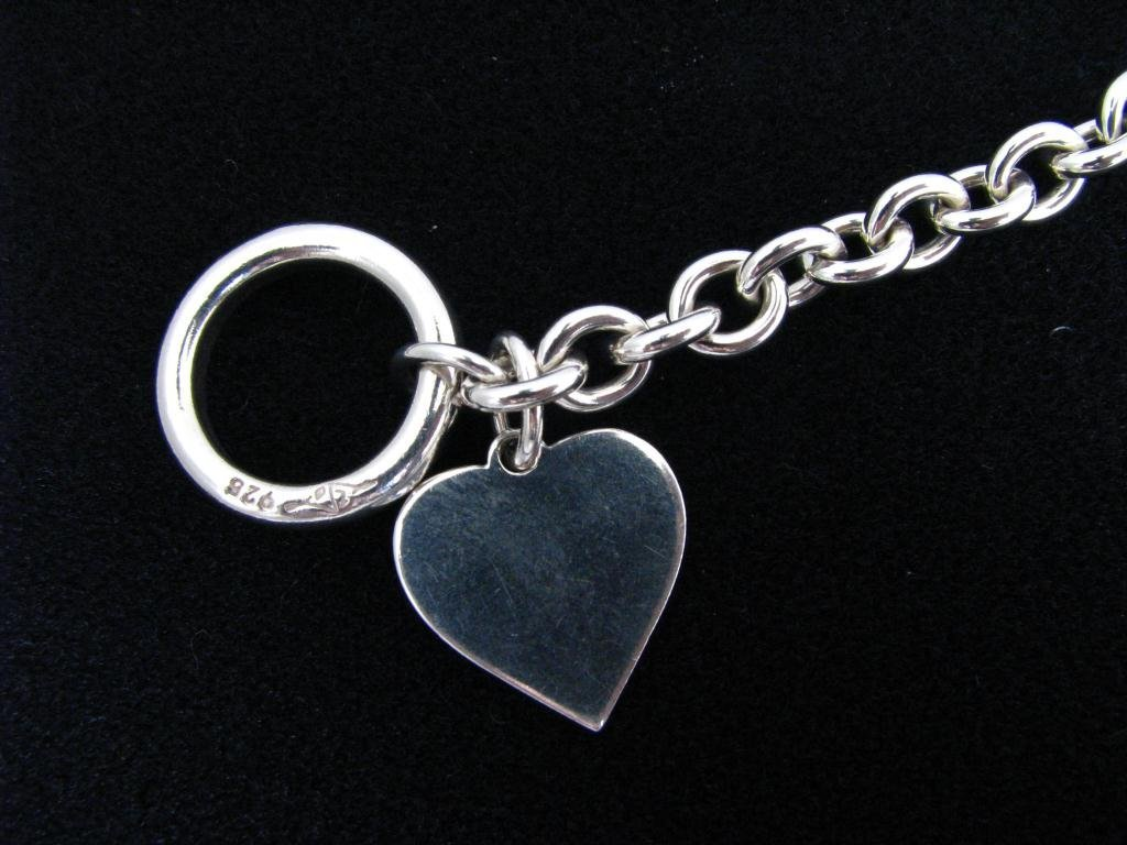 21: Sterling Silver Bracelet with Heart Charm