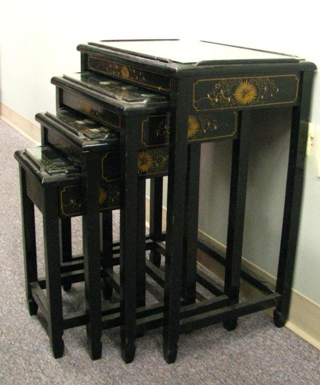 66: Set of Four Black Lacquer Oriental Nesting Tables