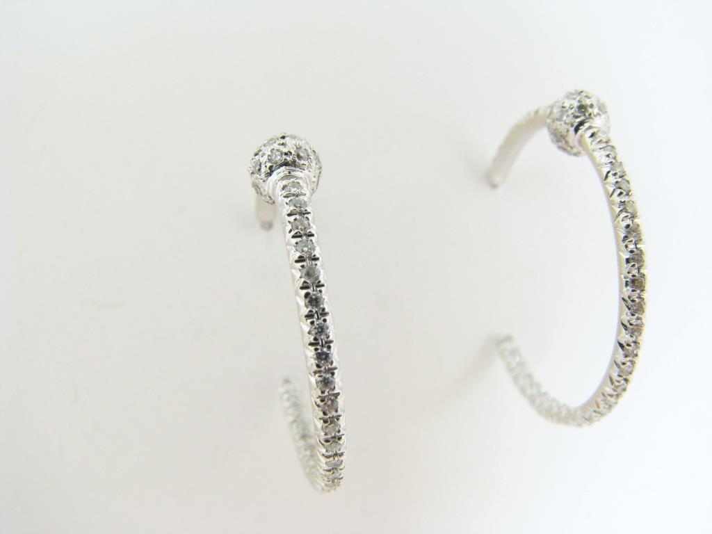 Pair of 18K White Gold Inside/Out Diamond Earrings