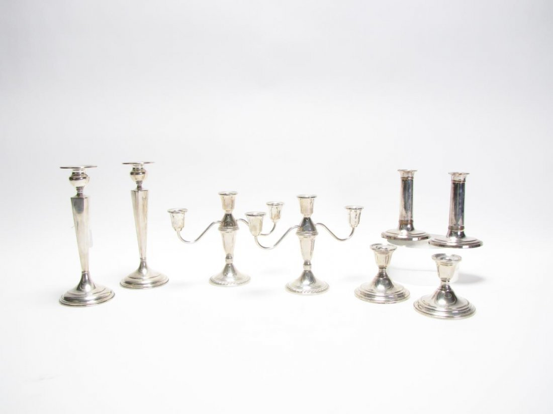 Four Pair of Weighted Sterling Candlesticks