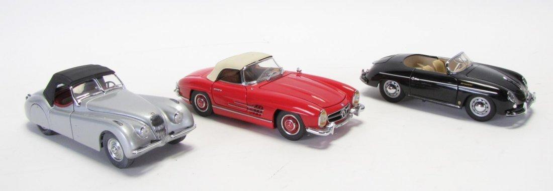 Three Franklin Mint Die Cast Cars