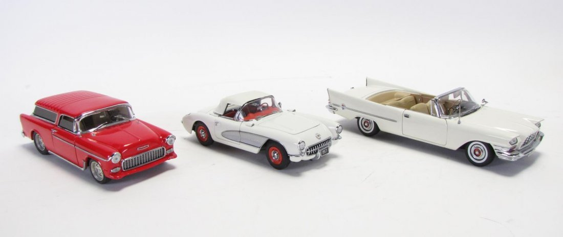 Three Danbury Mint Die Cast Cars