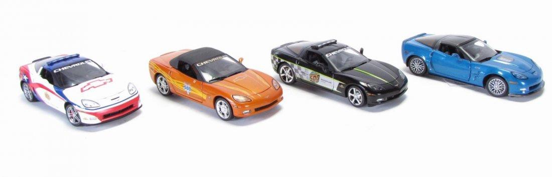 Four Franklin Mint Die Cast Cars