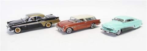 Three Danbury Mint Die Cast Cars