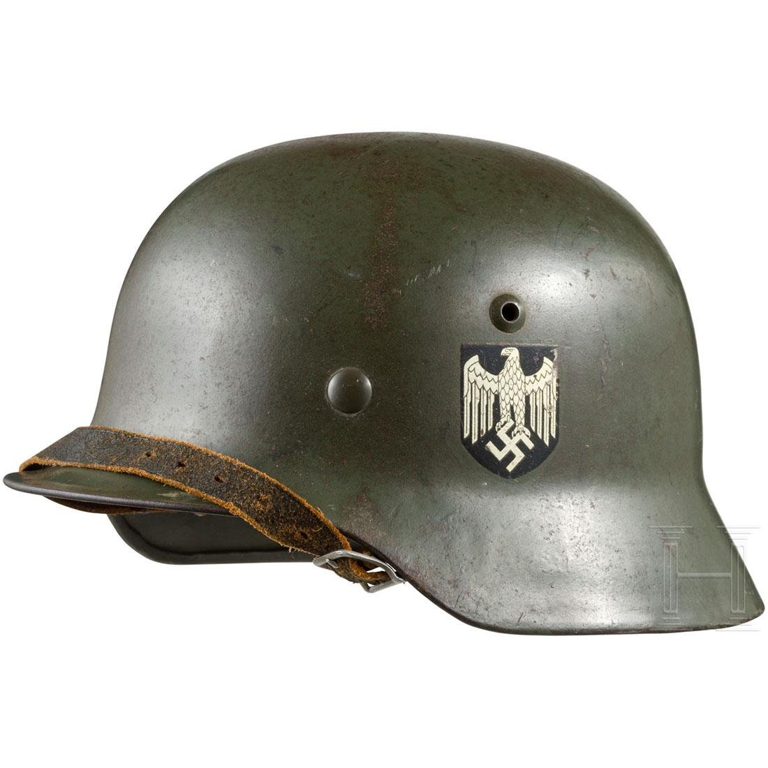 An M 35 steel helmet for the Army with both badges