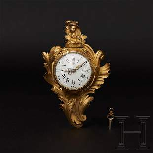 A small Louis XV mantel clock with a pocket watch
