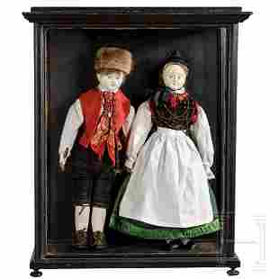 A showcase with a pair of dolls in Swabian costume,