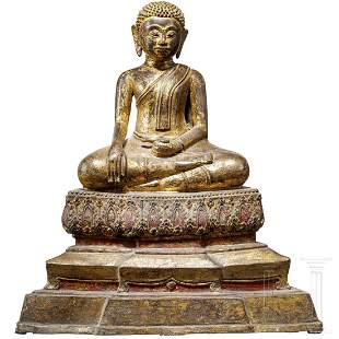 A gilded Thai bronze figure of the Buddha disciple