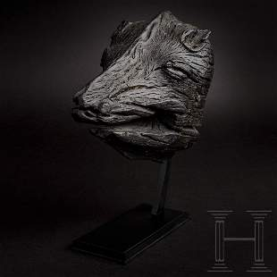 A Scandinavian Viking boar's head from a ship, 7th -
