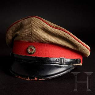 A visor cap to the tropical uniform for officers of the