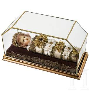 A large South German swaddled baby with wax head, circa