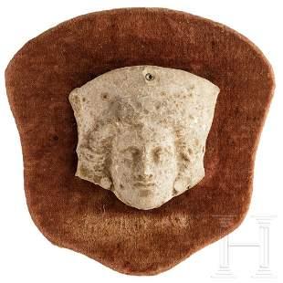 A Greek-Hellenistic terracotta head of Medusa(?), 3rd -