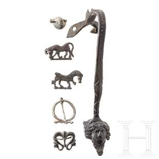 Four Roman brooches, a bronze handle and a lead seal,