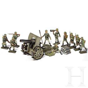 A Lineol mortar in grey and ten army soldiers with