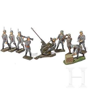 Nine Lineol and Armee Flak soldiers with 2 cm Flak