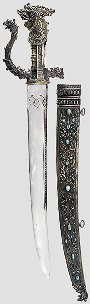 122: A silver-mounted kastane with watered damask blade