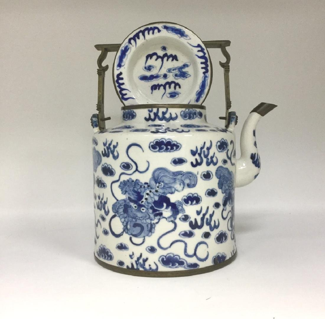 A LATE MING BLUE AND WHITE TEAPOT AND COVER