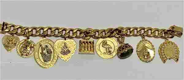 INCREDIBLE 18K GOLD JADE MASON CHARMS BRACELET