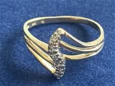 14 K GOLD AND DIAMOND RING SZ 7