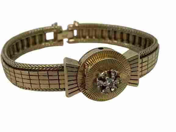 14 K GOLD AND DIAMOND ETTA BRACELET WATCH